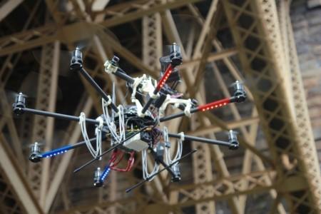 Robot flying under bridge